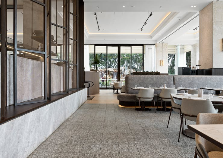 the slate grey dining room interior of a luxury resort