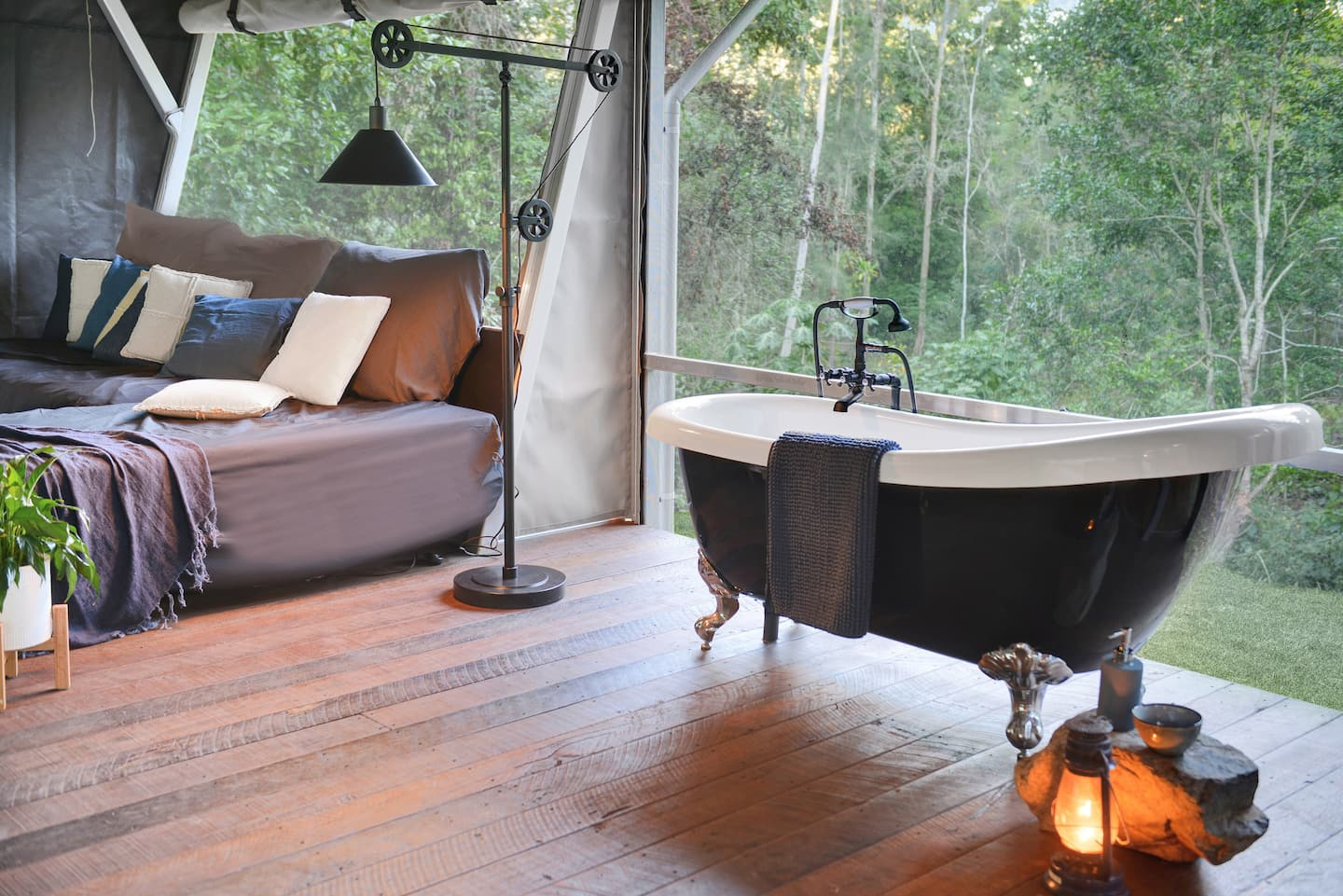 inside a tent with a bath and bed