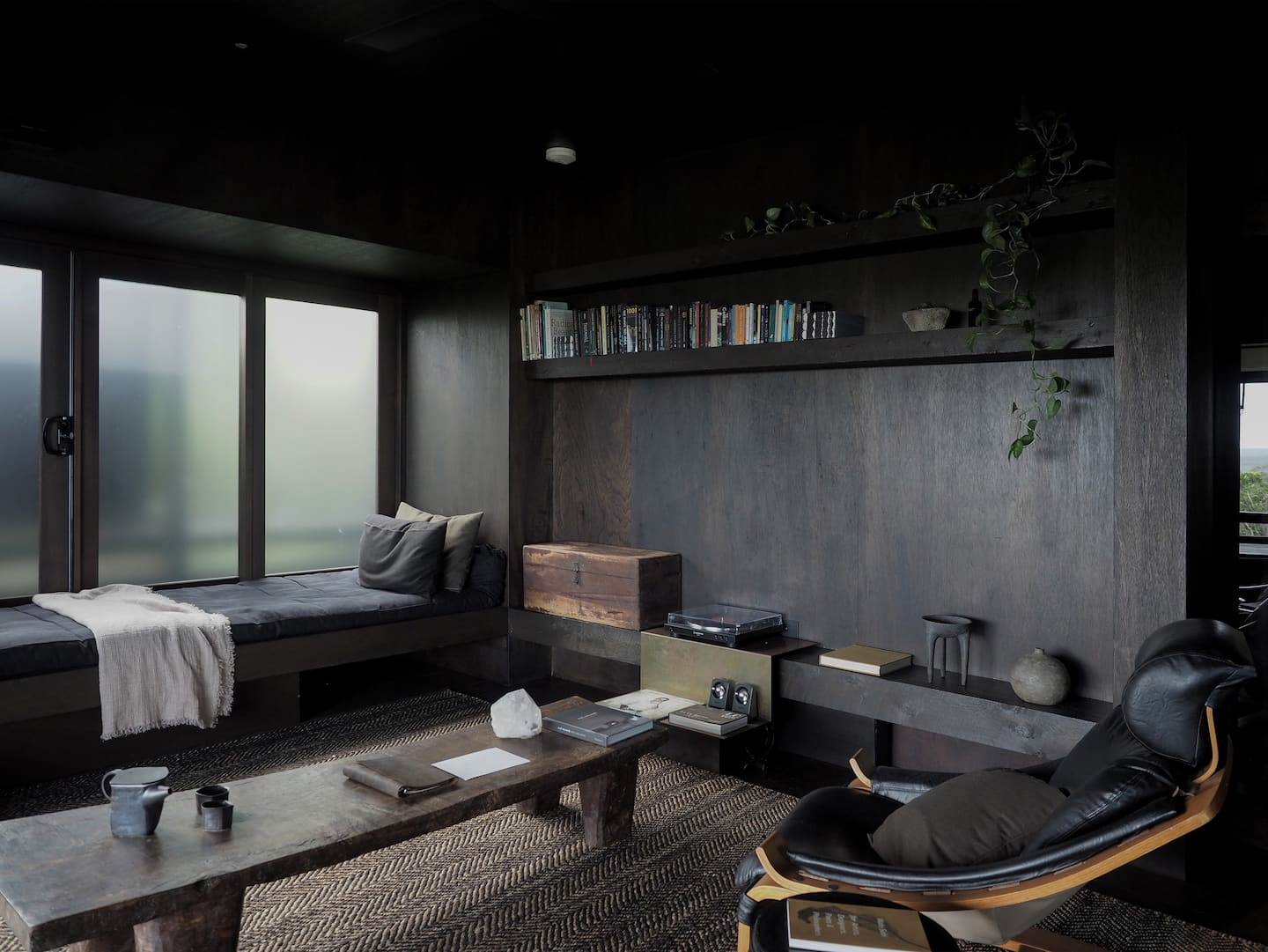 interior of an all black living room