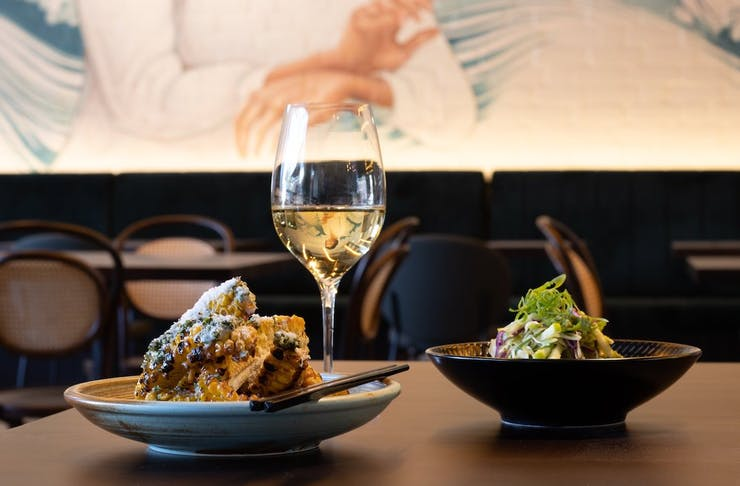Two plates of food and a glass of wine on a table at Emily Taylor