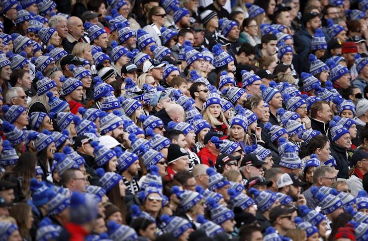 A crowd full of spectators wearing blue FightMND beanies.