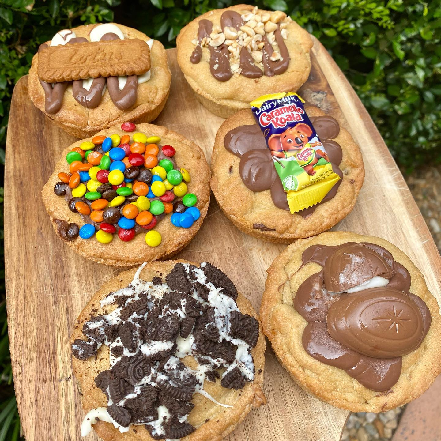 a wooden board piled with cookie pies