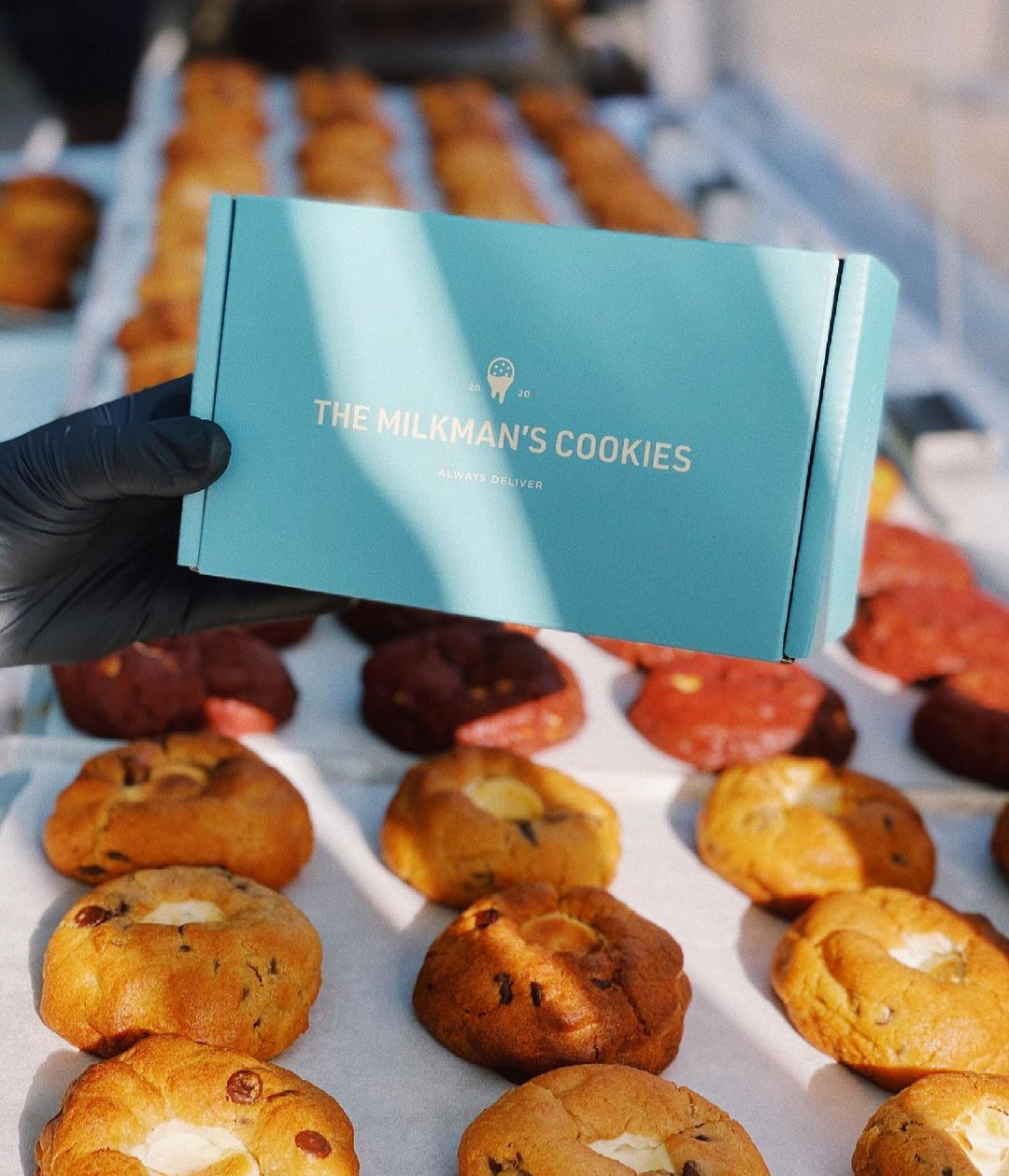 a turquoise box against a backdrop of cookies