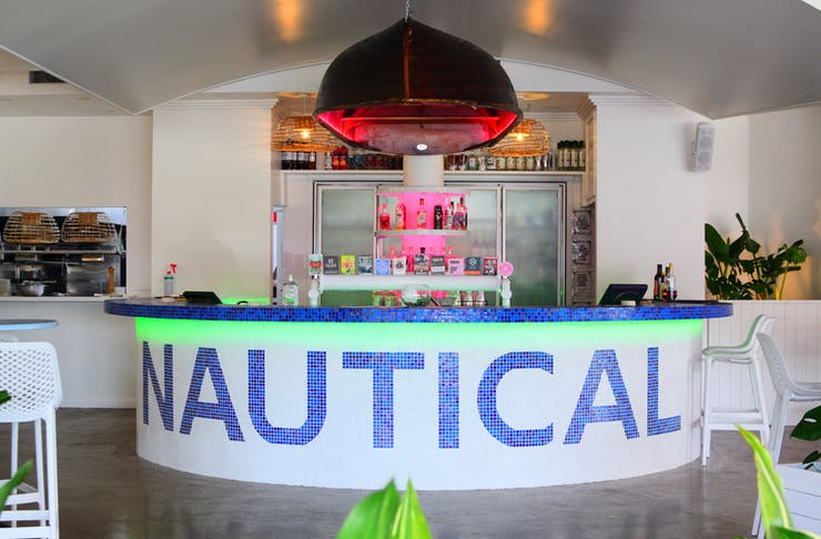 a white bar with a navy blue mosaic design that says 'nautical'