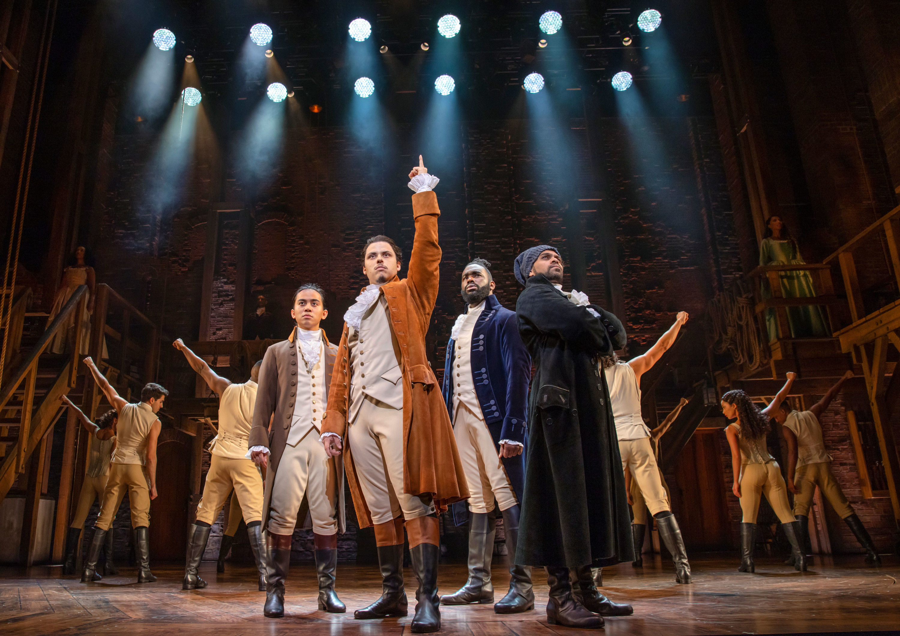 a photo of the australian cast of hamilton on stage