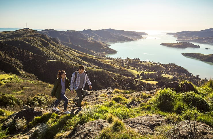 A couple walking in Port Hills