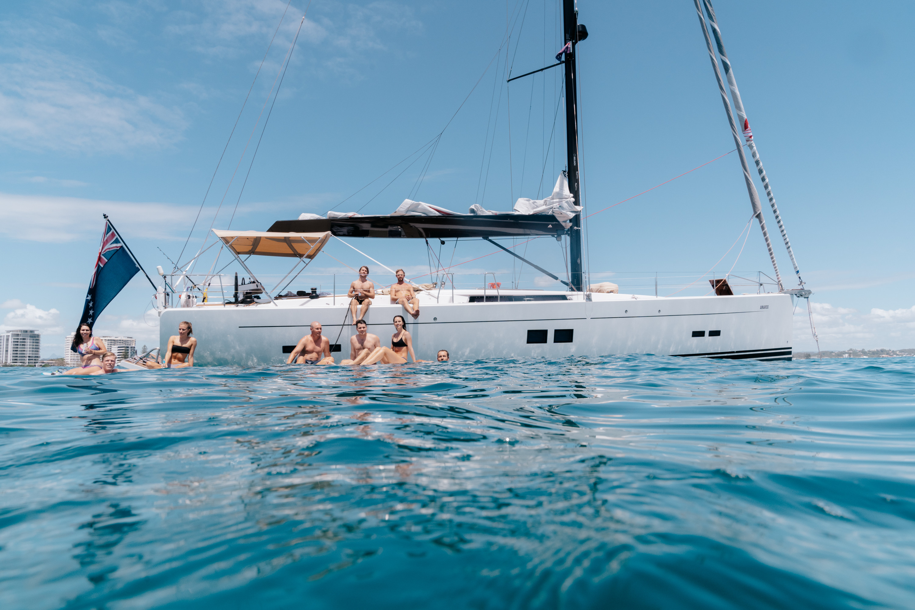 a group of people sitting on a yacht