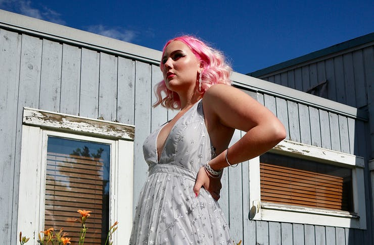a woman with pink hair