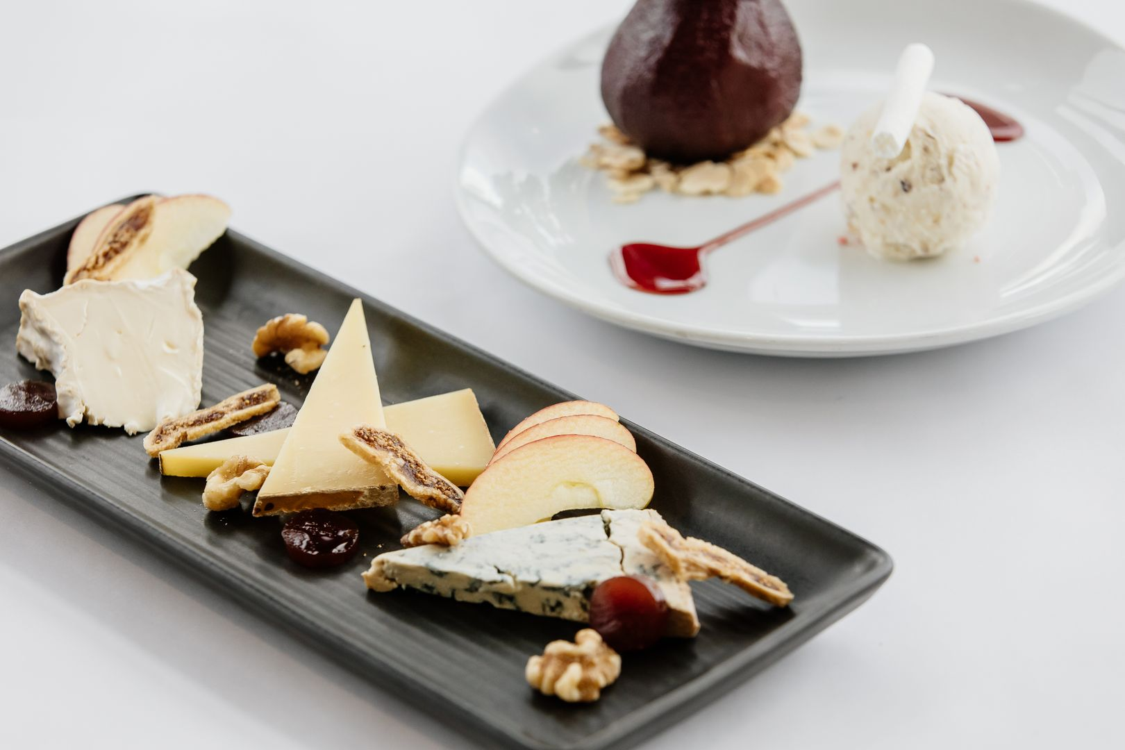 a cheese plate and a French dessert