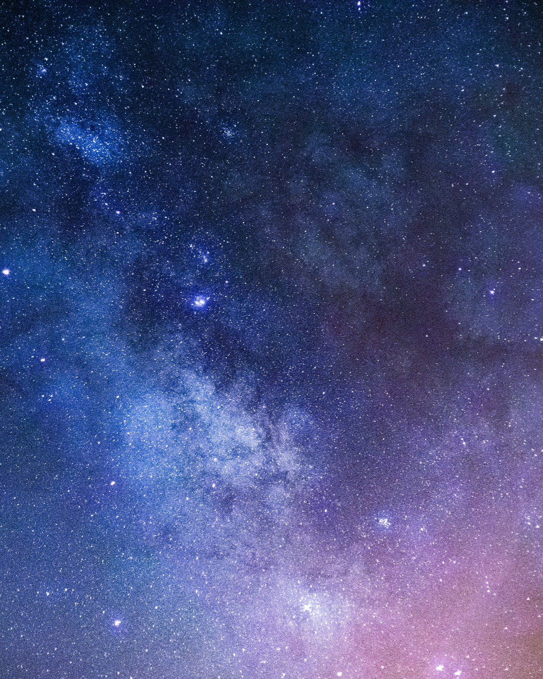 A deep blue night sky with stars and purple moments.