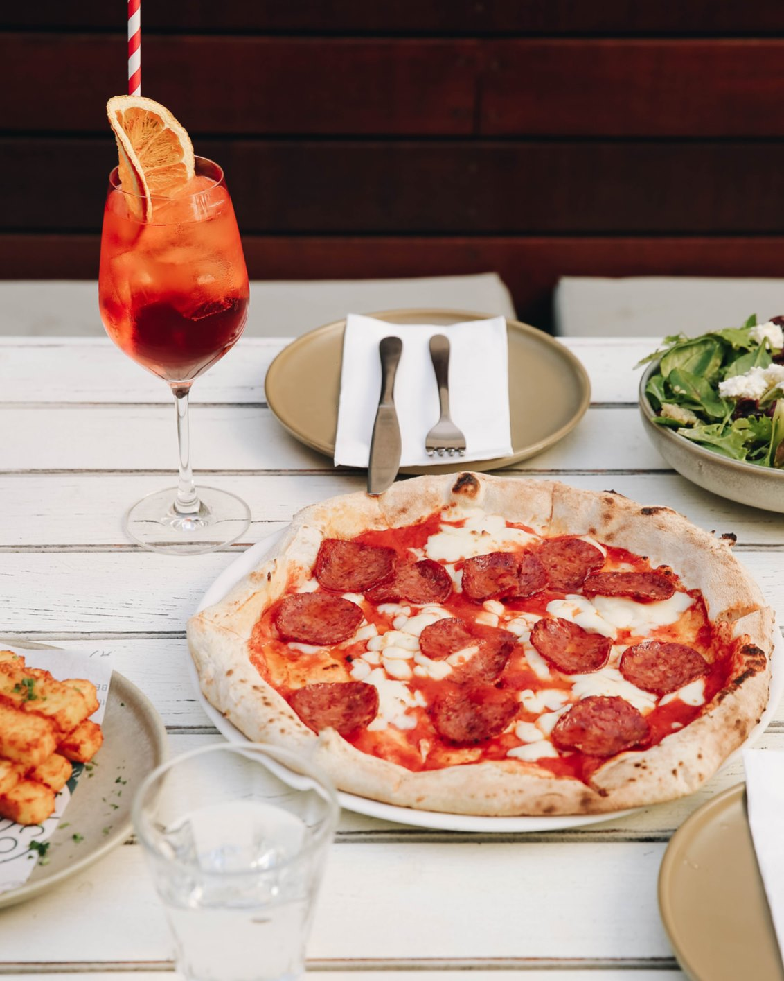 a pizza and a cocktail on a table