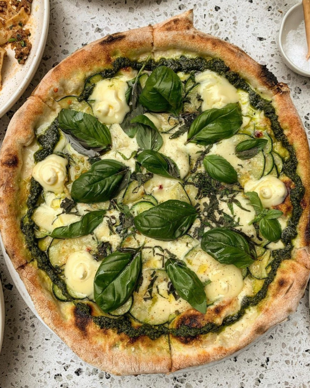 Delicious vegetarian pizza on a plate - Non Solo Pizza's 'Nerano' made with marinated zucchini, whipped stracchino cheese, parmesan, green pesto and lots of basil
