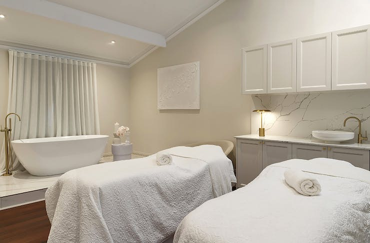 Treatment room with a bath at olive and july south perth