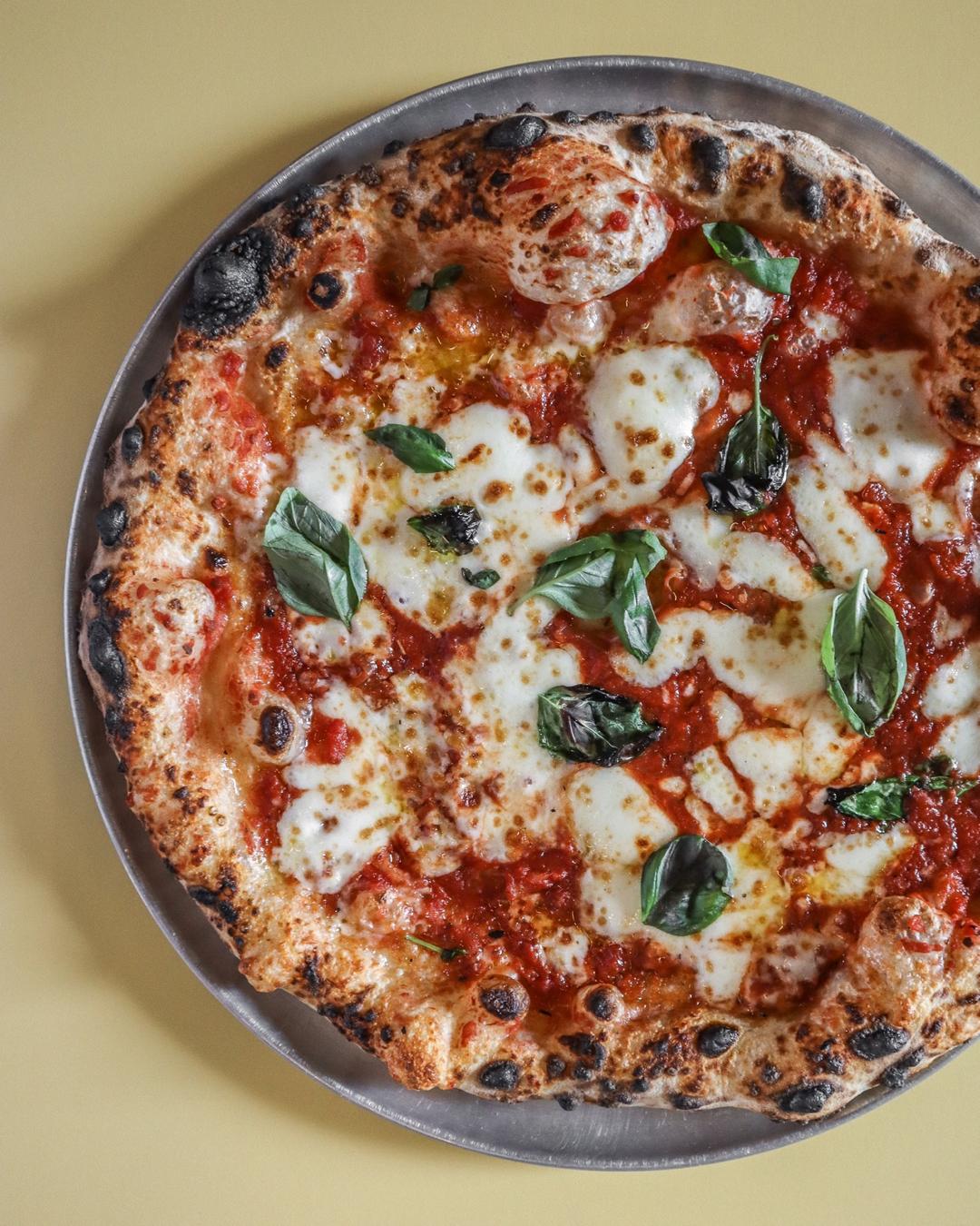 Tomato, buffalo mozzarella, fresh basil and extra virgin olive oil on Umu Pizza's sourdough base