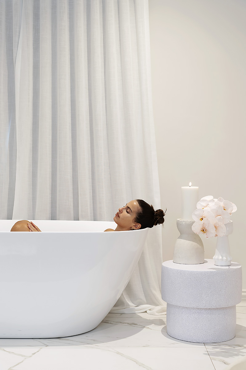A woman in a bath at Olive and July South Perth