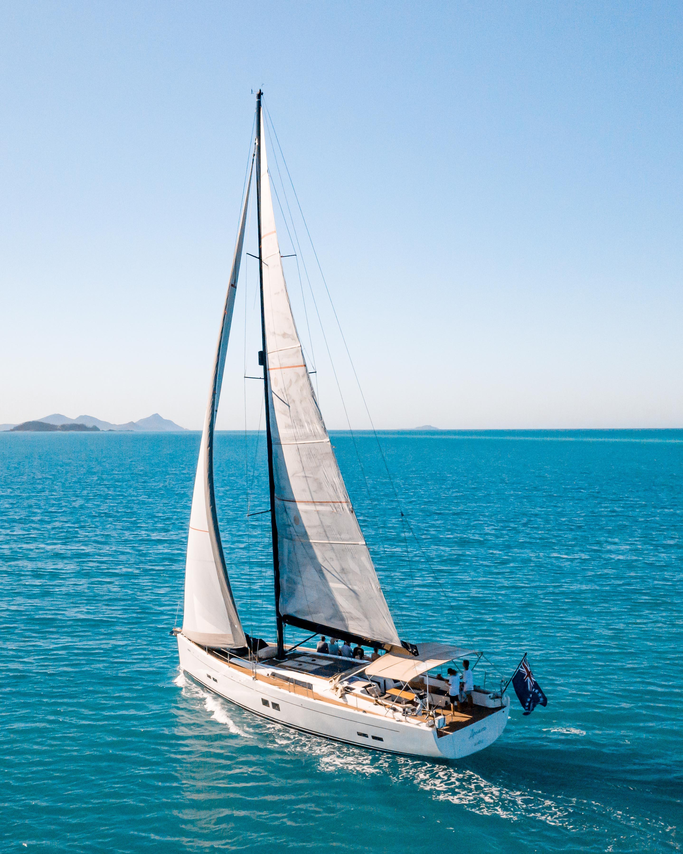 a luxury yacht against a blue sky