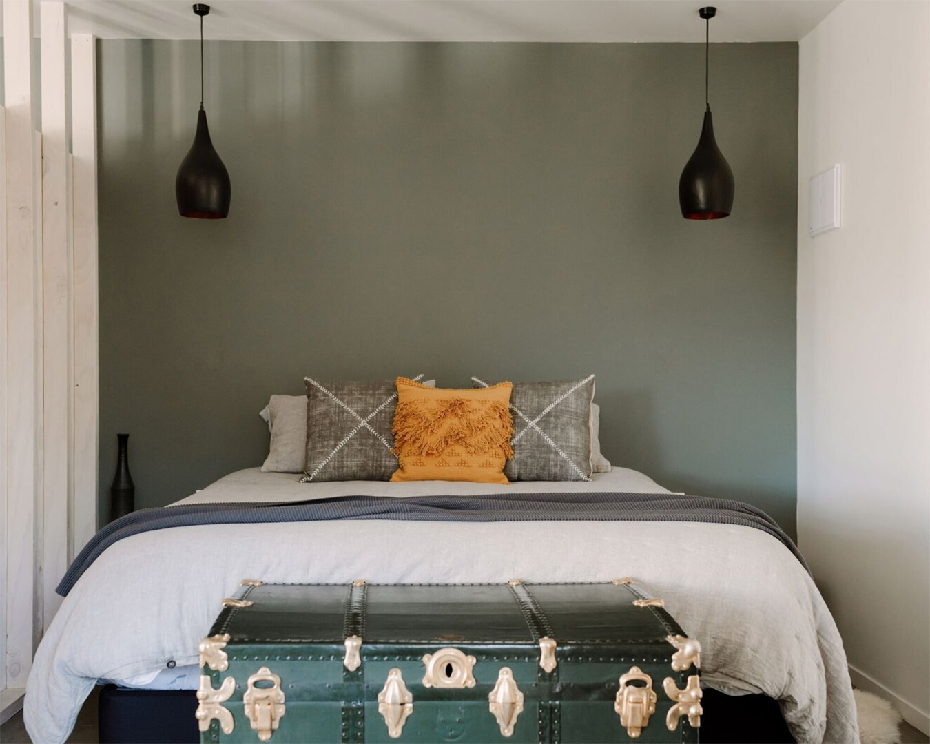 A bedroom at Three Streams showing a comfy bed and country furnishings.