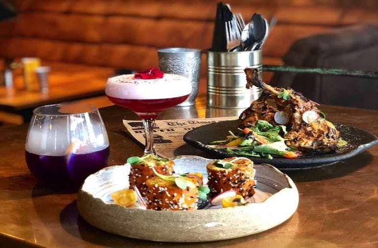A delicious spread of cocktails and Indian-inspired meals.