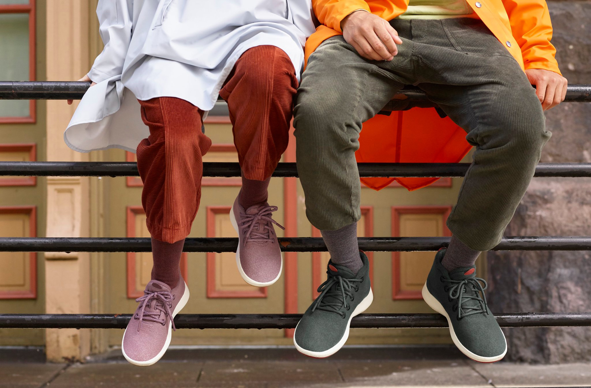 Peoples legs wearing allbird sneakers.