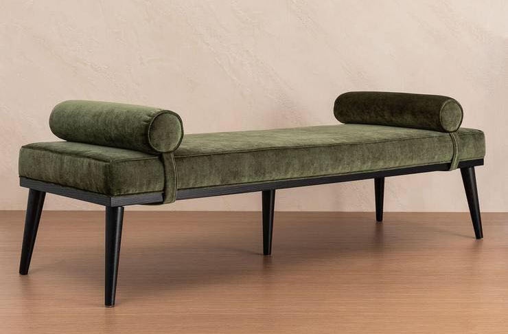 An image of a green velvet bench seat from Lore