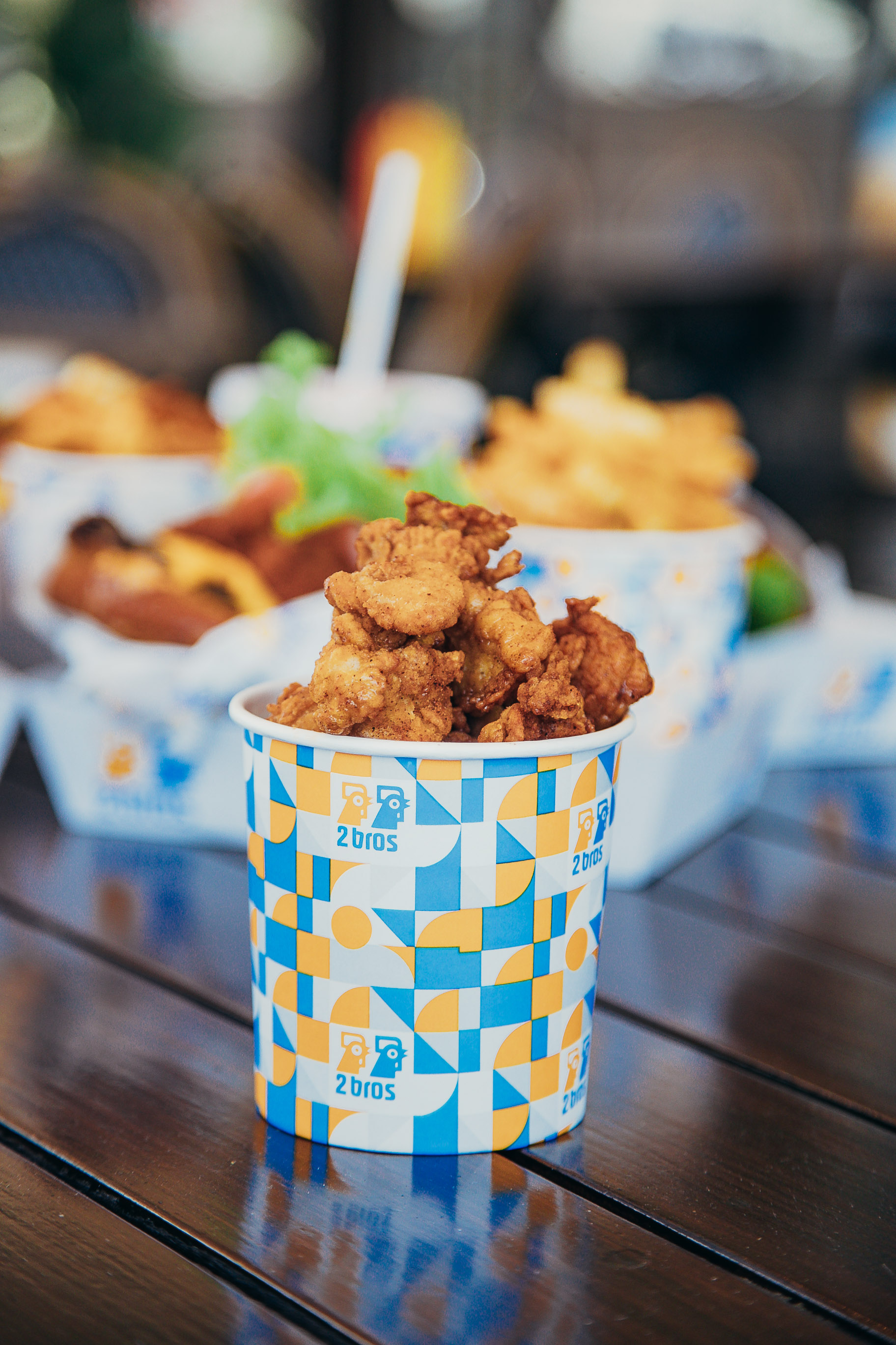 a cute blue bucket filled with chicken nuggets
