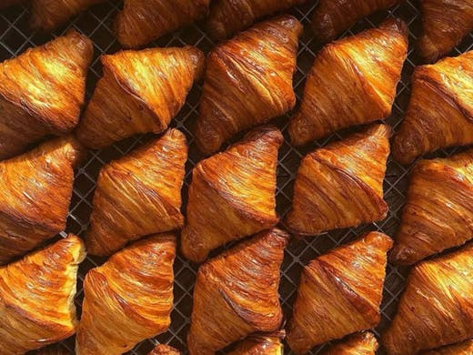 Rows of freshly baked croissants from AP Bakery