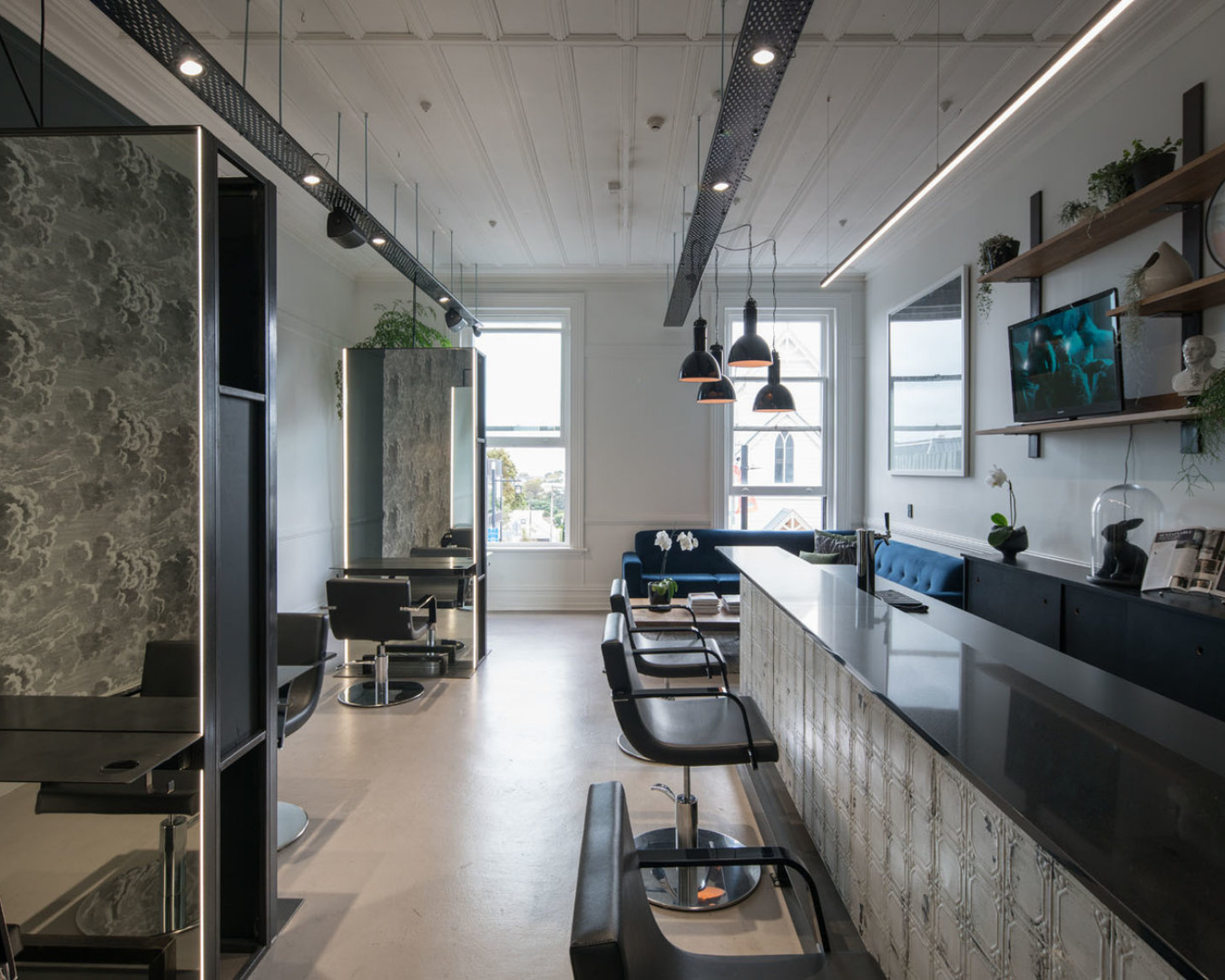 Inside of the salon with artistic décor and a posh lounge area