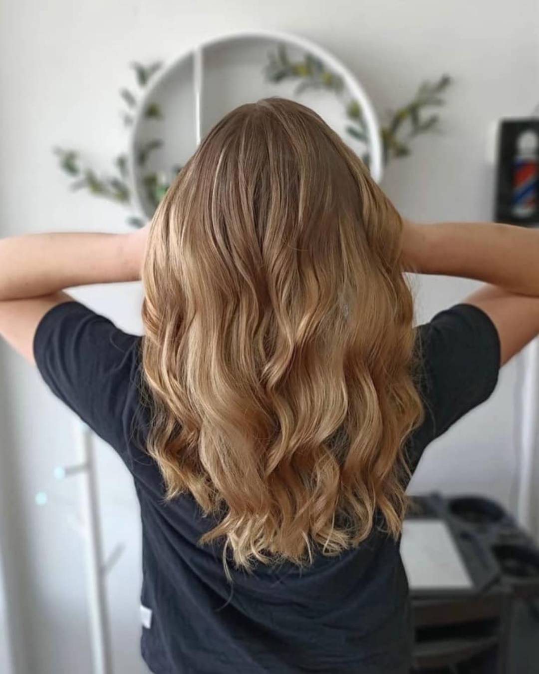Woman posing with her beautiful hair after a hair cut in the salon.