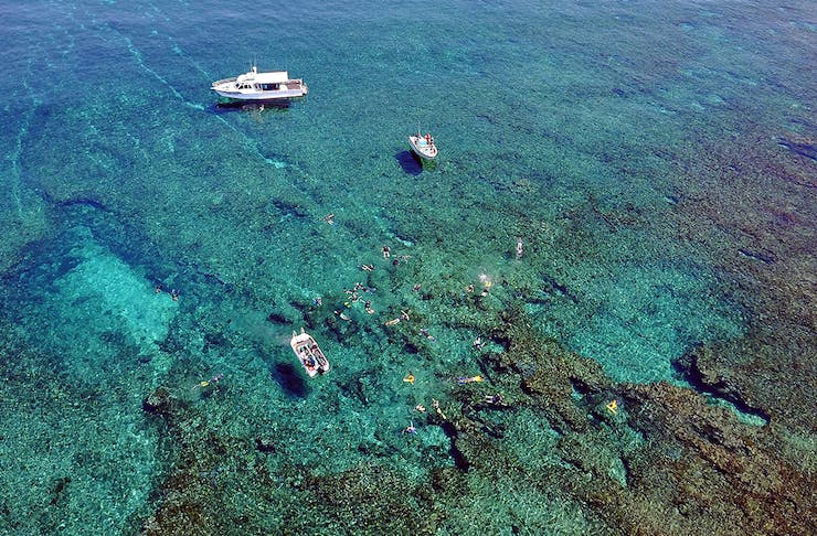 Drone image of the Eco Abrolhos as passengers snorkel nearby