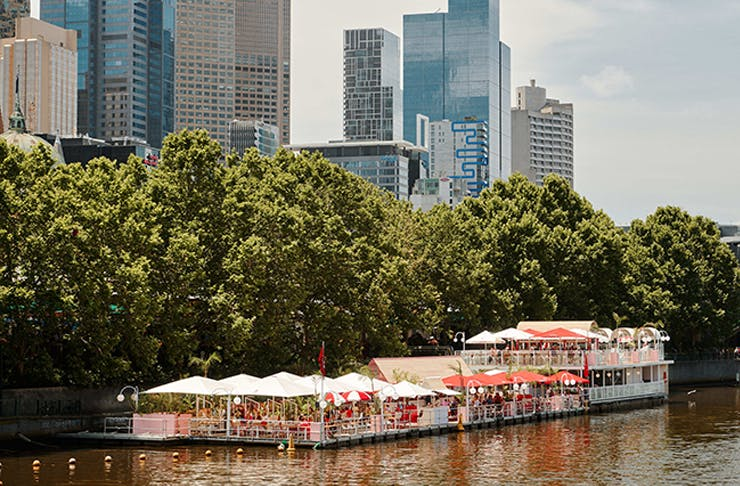 A shot of Arbory Afloat from a distance with the river and the city in the background.