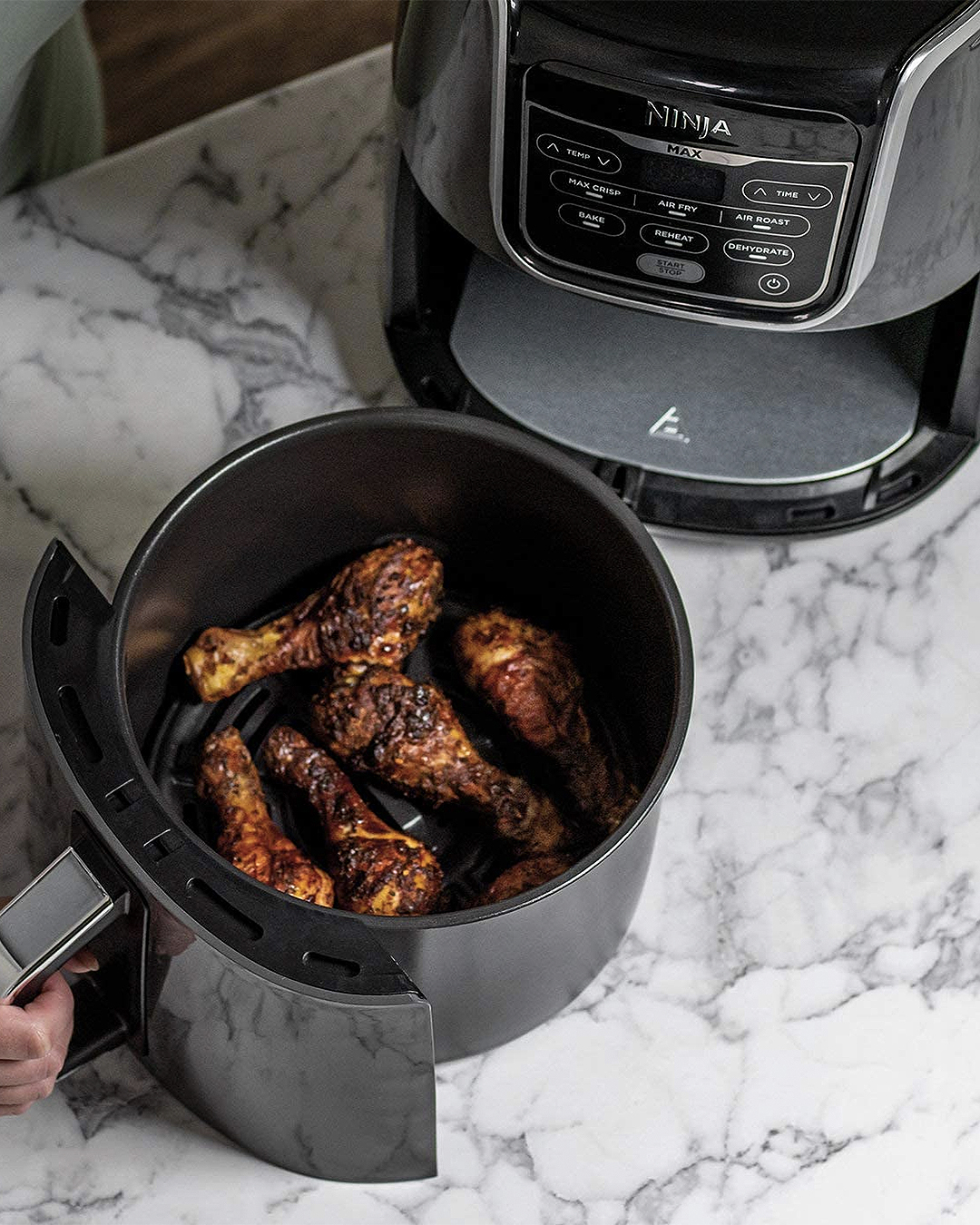 The Ninja Air Fryer Max with a bucket of fried chicken on display.