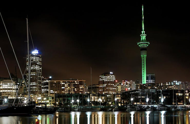 A view of the Sky Tower all decked out in green lighting