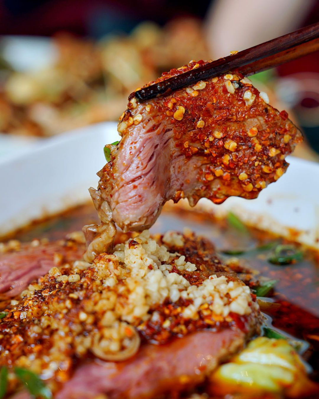 Sliced wagyu beef dipped in boiling Sichuan soup from Fang