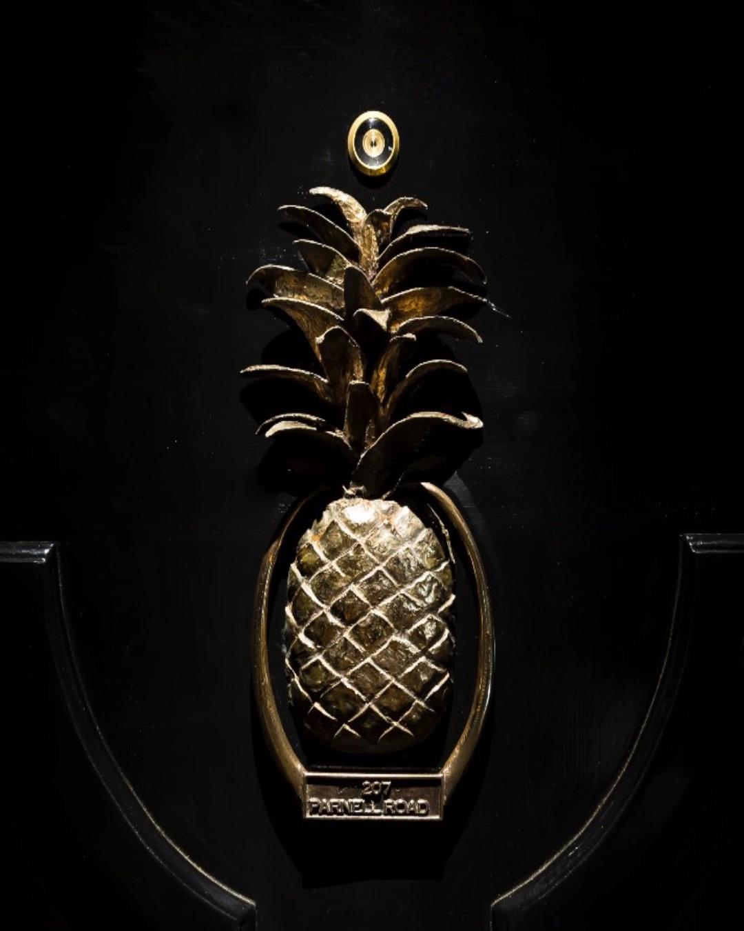 Brass pineapple door knocker on the door to Pineapple on Parnell.