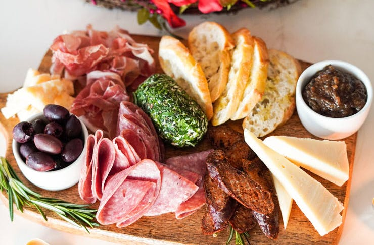 A charcuterie board with Italian-style snacks