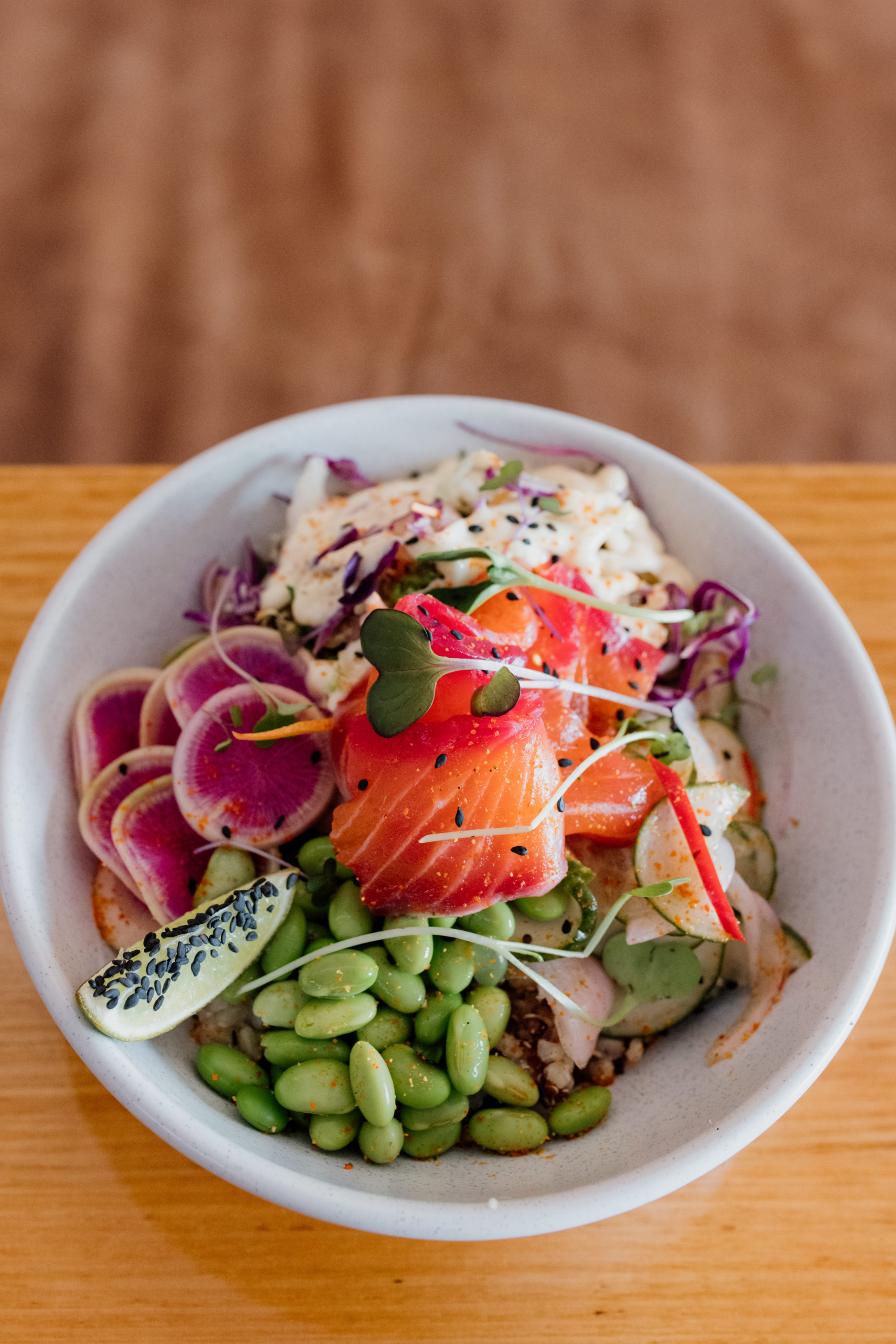 a close-up of a salmon bowl