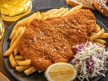 From Bottomless Beers And Cocktails To Crispy Schnitzels, Get Around This Epic Feast With Your Crew