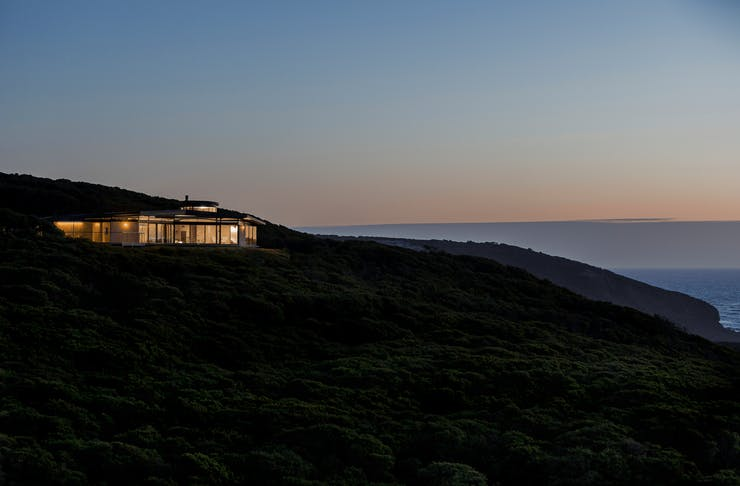 An airbnb on a hill overlooking the ocean.