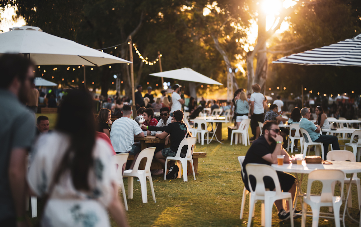 people sitting at outdoor tables at the Beer and Beef Festival in Perth