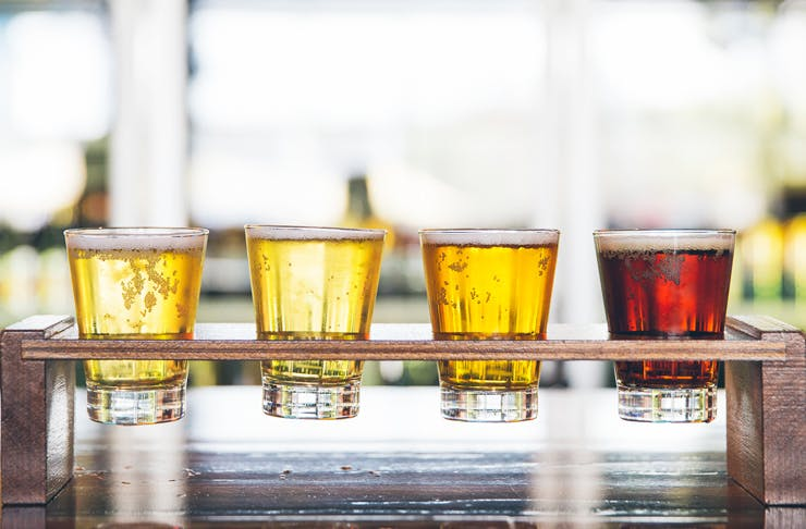 Four Beers in a wooden tasting tray