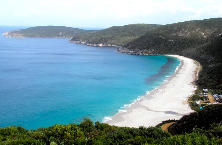 Turquoise waters and white sand of Shelley Beach as seen from above
