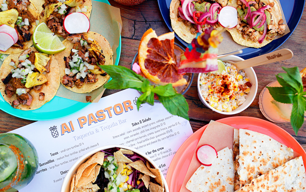 Table loaded with tacos, tostadas, cocktails and more at Al Pastor in Fremantle