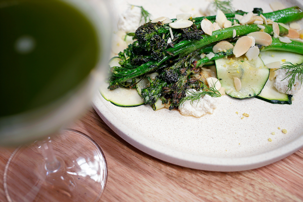 Broccolini dish and a cocktail at Mother