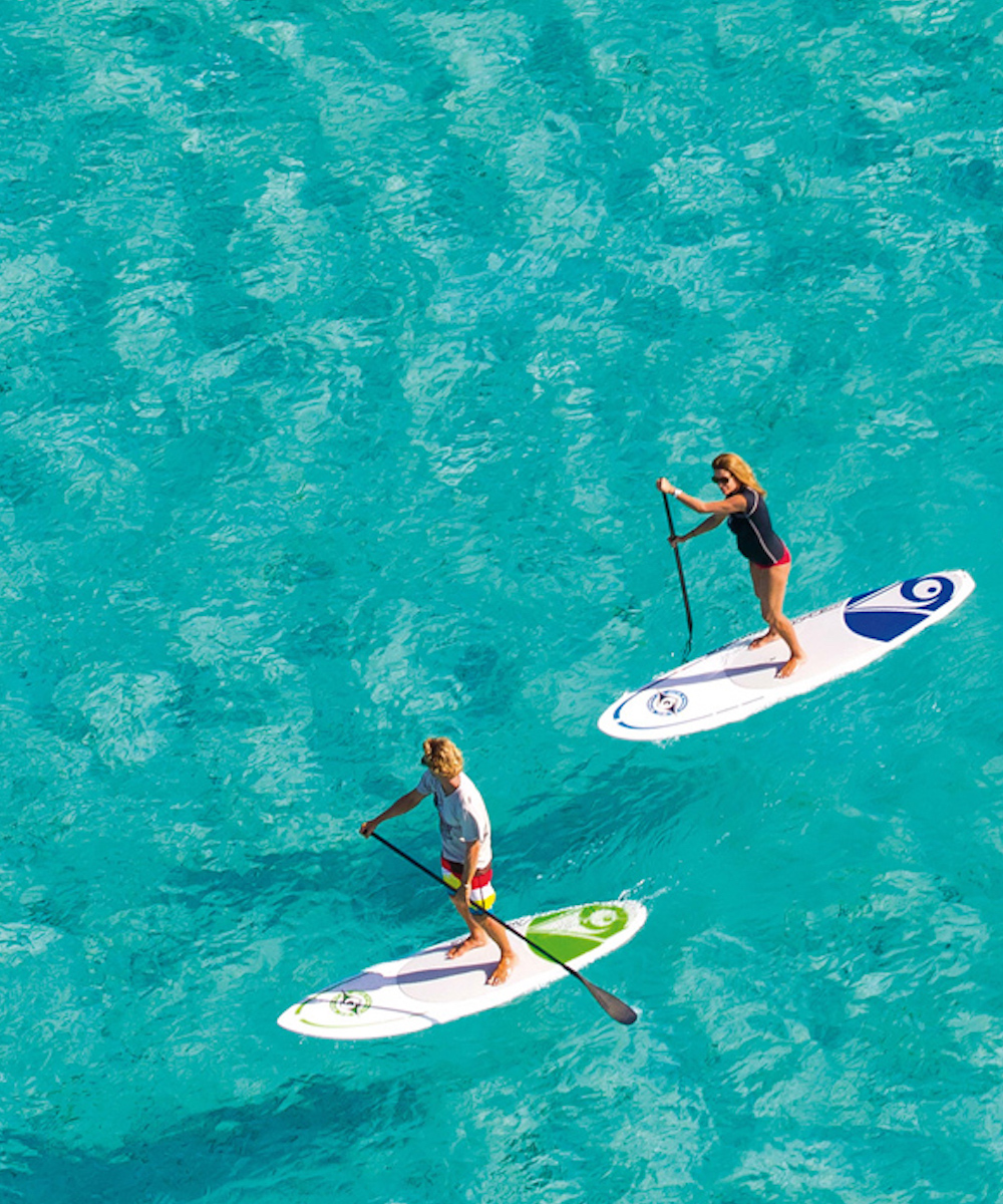 People stand up paddle boarding