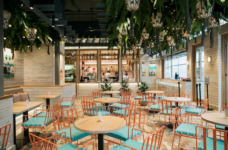 The colourful interior with turquoise and orange accents of Betty's Burgers on Hastings Street.