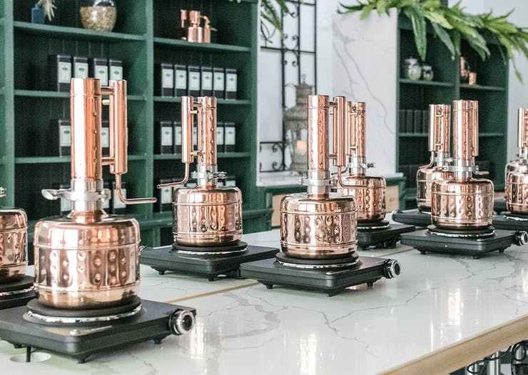 the copper stills inside the distillery's gin school