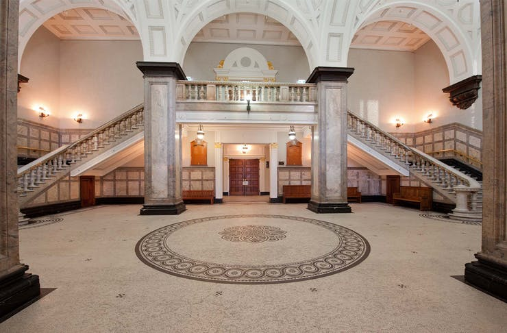 interior of brisbanes town hall with a grand staircase