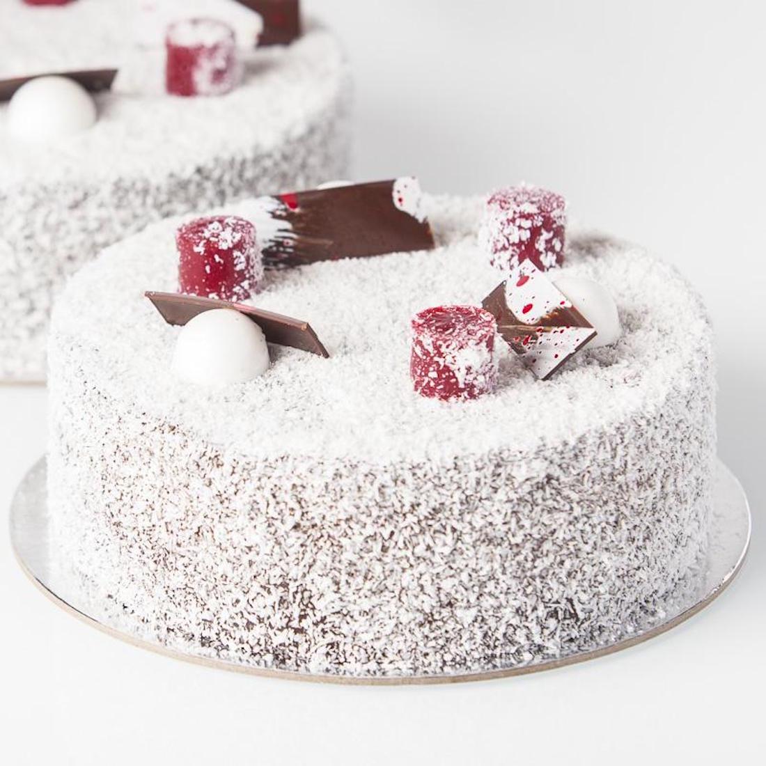 A lamington cake sits atop silver foil.
