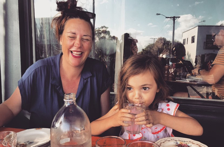 Renee is laughing whilst her daughter drinks water