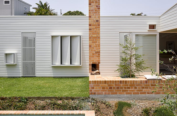 A shot of the white timber exterior of the Cantala Avenue house.